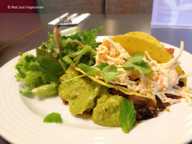 Vegan gluten free corn tacos with blackened beans, guacamole, and vegan slaw at SAF in London