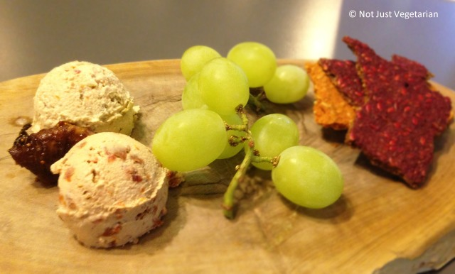 Fermented cashew cheese with grapes and flax seed crackers at SAF in London