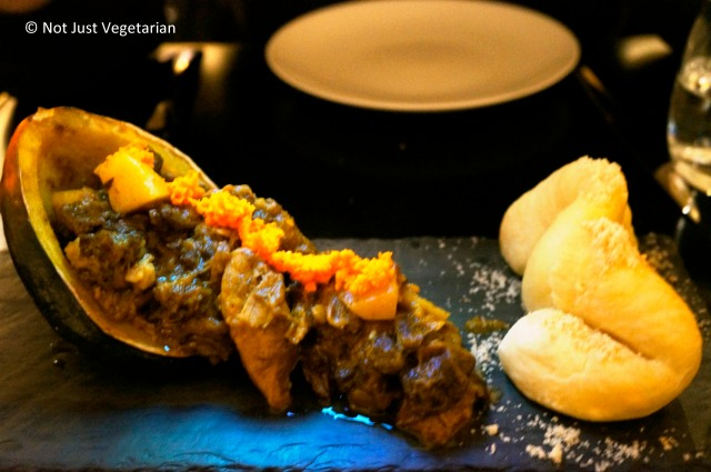 Curried Goat with acorn squash, coco bread, and pickled turmeric at Alder NYC