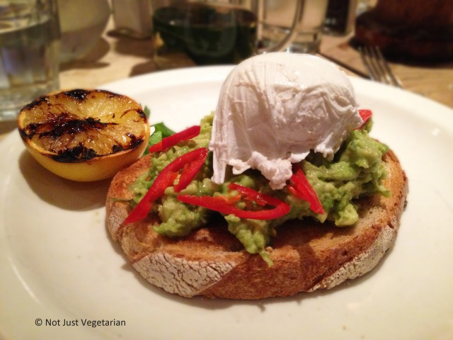 Avocado with fresh red chilli on grilled sourdough topped with poached egg at Annie's Barnes in London
