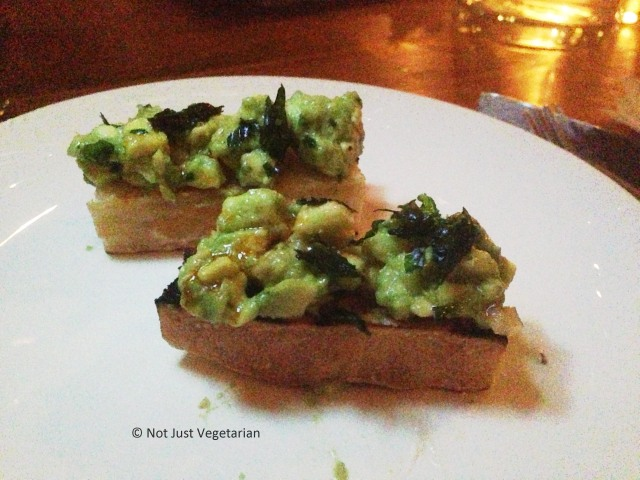 Avocado, lemon and espelette on toast at Beauty & Essex in NYC