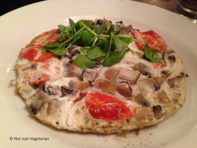 Egg-white fritatta with mushrooms, onions, and tomatoes at Bumpkin, South Kensington, London