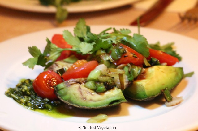 Grilled Avocado with pistachio lime pesto, tomatoes and coriander at ffiona's in London