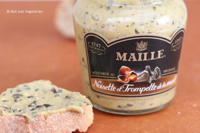 Maille mustard with hazelnut and black chanterelle mushroom on a toasted baguette