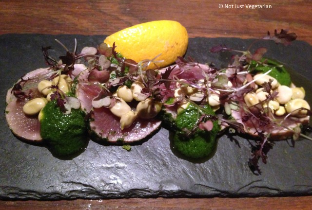 Tuna carpaccio with broad beans and salsa verde at Salt Yard in London