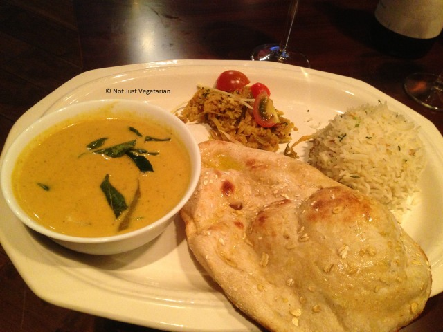 Goa Fish curry, shredded Cabbage Mysore Style with mixed cereal naan and steamed basmati rice at Indali Lounge in London