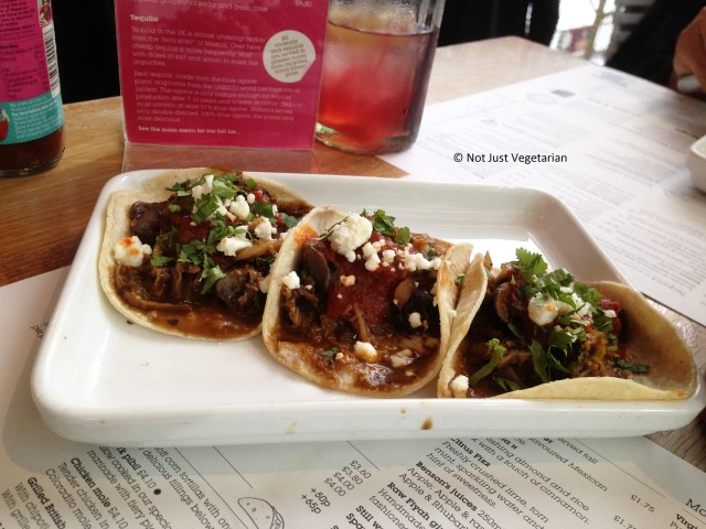 Winter vegetable tacos with savoy cabbage, mixed mushrooms and borlotti beans in chilli pasilla salsa, with roast chipotle salsa and feta) at Wahaca in London
