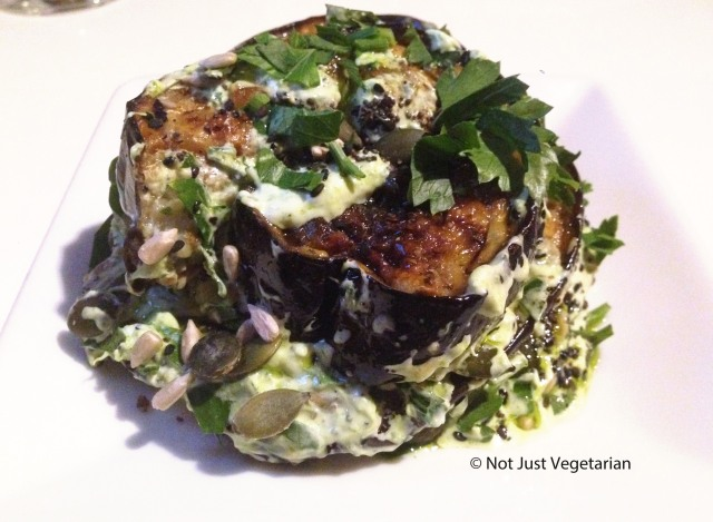 Roasted aubergine with parsely yoghrt, parsley oil and mixed seeds at Ottolenghi Islington in london