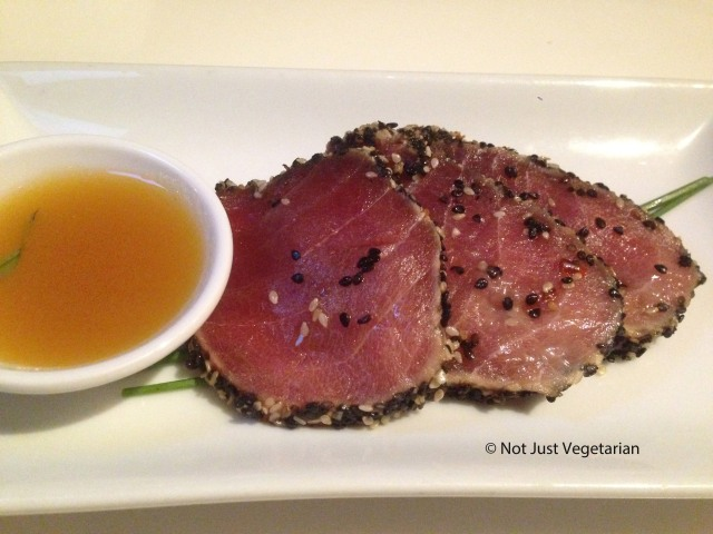 Yellow fin seared tuna with sesame seeds, served with a soy, honey, spring onion and ginger sauce at Ottolenghi Islington in London