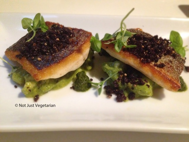 Pan-fried sea bass with a tomatillo, avocado and jalapeno salsa and olive soil at Ottolenghi Islington in London