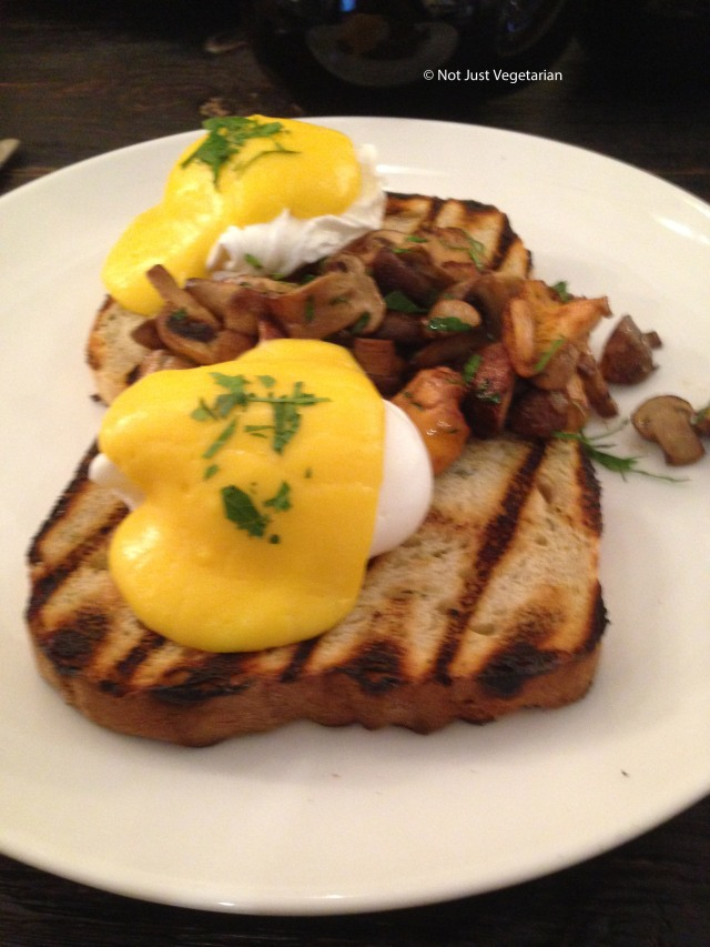 Wild mushrooms and poached eggs on onion bread with Hollandaise sauce at Apero in London