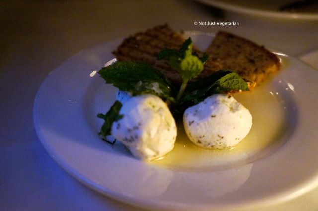 Homilka - sheep's curd cheese with fresh mint and sea salt in olive oil and herbs at Ognisko in London