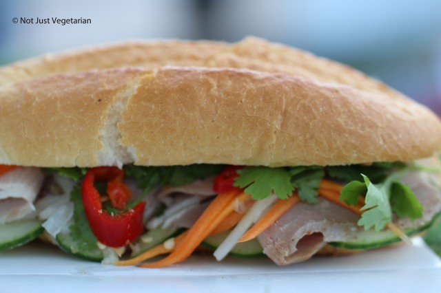 Banh mi with sliced smoked pork shoulder, pickled carrots and daikon in a chili coriander dressing from The House of Ho at the Taste of London 2014